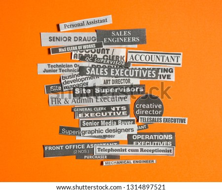 Jobs or careers concept: multiple job titles or occupations cut off from newspaper on orange background #1314897521