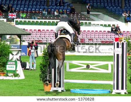 Jockey and horse jumping over obstacle at Jump and Dressage Derby, Hamburg, Germany, May 2006