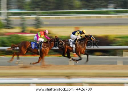 Jockeys on a horses racing on race track