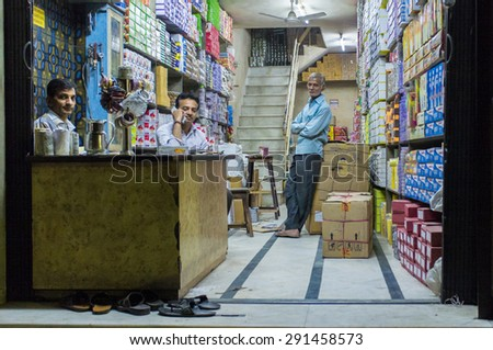 JODHPUR, INDIA - 16 FEBRUARY 2015: Three Indian men in textile store.