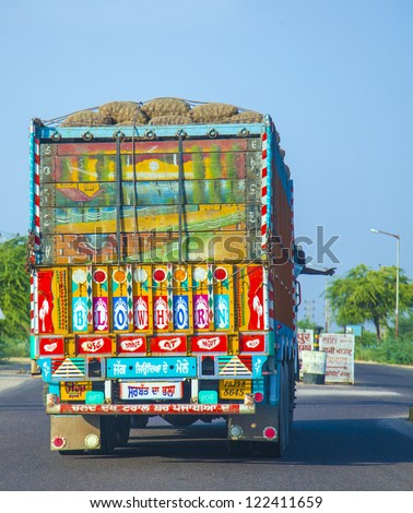 JODHPUR, INDIA - OCTOBER 23: painted back of a truck in Jodhpur on October 23, 2012. Most trucks are painted with religious motives and or hints like blow horn please.