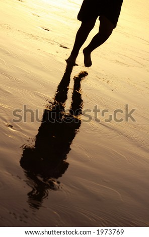 jogger at sunset with reflection and footsteps