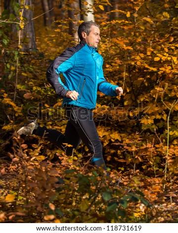 jogger in autumn - stock photo