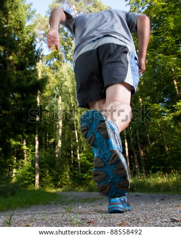 jogger on a trail in the forest