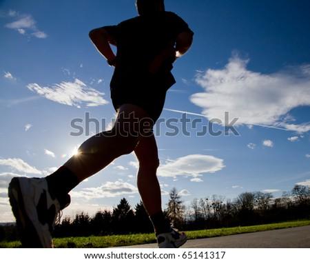 jogger running in back light