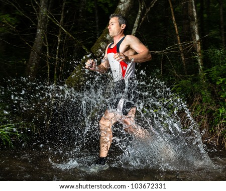 jogger running through a streambed