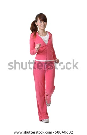 Jogging girl with joy, full length portrait isolated on white background.