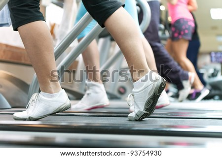 Jogging on treadmill, focus on the treadmill, blurred motion