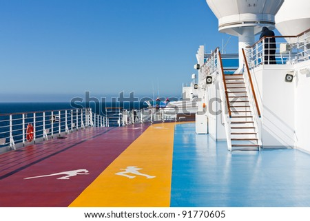 jogging tracks in recreation area on upper deck of cruise liner
