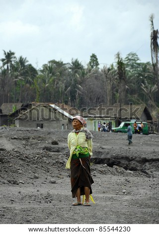 JOGJAKARTA, INDONESIA - APRIL 3: Dejected residents affected by continuous ash flow from eruption of Mt. Merapi awaiting govt assistance in Juomo Megalang district on April 3, 2011 in Jogjakarta