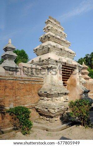 JOGJAKARTA, INDONESIA -JUNE 12, 2014: Entrance arch at old Masjid Besar Mataram Kotagede, Jogjakarta Indonesia. The arch was made from brick and hand made carving stone in traditional Balinese Style