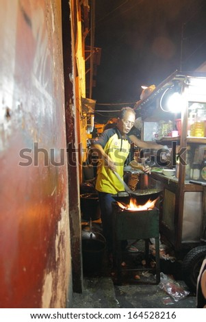 JOGYAKARTA INDONESIA - May 10:Unidentified chef cooks at a street restaurant on Malioboro street - May 10,2013 in Jogyakart Indonesia. Malioboro street is the most vibrant street in Jogyakarta.