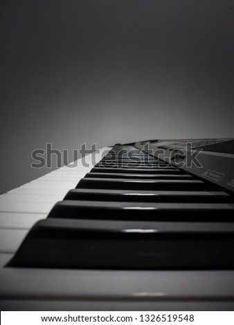 Johannesburg , Gauteng / South Africa - February 27 2019 :  close up of electronic keyboard keys and dark background midday johannesburg #1326519548