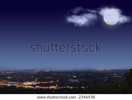 Johannesburg night cityscape with big bright moon and clouds on blue black sky