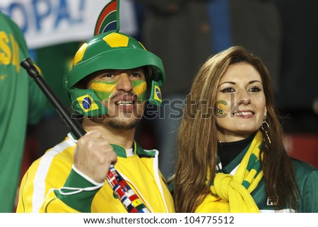 JOHANNESBURG, SOUTH AFRICA - JUNE 15:  Brazil supporters watch the action at a 2010 FIFA World Cup match June 15, 2010 in Johannesburg, South Africa.  Editorial use only.