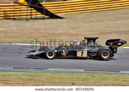JOHANNESBURG, SOUTH AFRICA- MARCH 20: Historic Formula One racing car drives round the track at the Topgear Festival in a display race on  March 20, 2011 at Kyalami in Johannesburg, South Africa