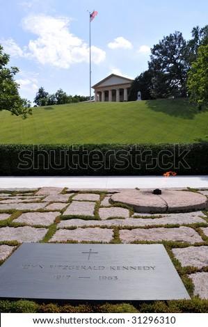 John F. Kennedy's grave, the eternal flame, and Arlington House in the background, at the Arlington National Cemetery in Arlington, Virginia, near Washington DC