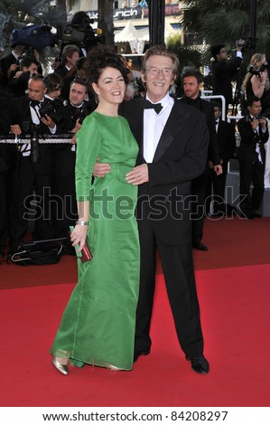 """John Hurt & wife at premiere for """"Indiana Jones and the Kingdom of the Crystal Skull"""" at the 61st Annual Cannes Film Festival. May 18, 2008  Cannes, France. Picture: Paul Smith / Featureflash - stock photo"""
