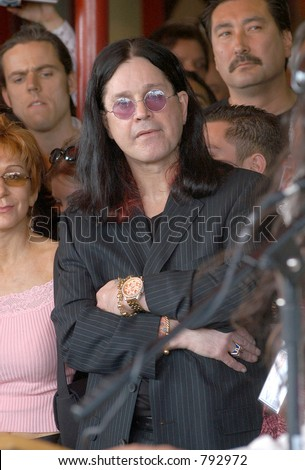 "John ""Ozzy"" and Sharon Osborn at the honoring of the late Randy Rhoads  to the Hollywood Rock Walk of Fame, Los Angeles, Ca, 03/19/04"