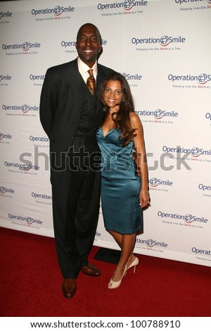 John Salley Wife Natasha Duffy http://www.shutterstock.com/pic-100788910/stock-photo-john-salley-and-wife-natasha-duffy-at-the-th-annual-smile-gala-benefiting-operation-smile-beverly.html