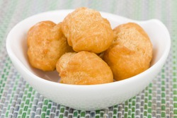 Johnny Cakes - Jamaican fried dumplings in a white bowl.