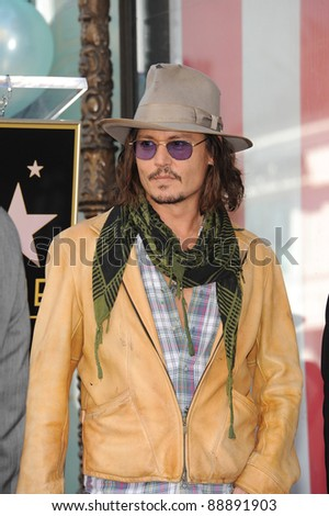 Johnny Depp on Hollywood Boulevard where actress Penelope Cruz was honored with the 2,436th star on the Hollywood Walk of Fame. April 1, 2011  Los Angeles, CA Picture: Paul Smith / Featureflash