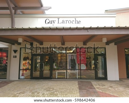 coach store premium outlets 0bmp  JOHOR BAHRU, MALAYSIA- 10 Mac 2017: Guy Laroche store in Johor Premium  Outlet