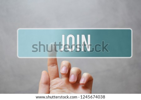 Join - finger pressing blue transparent button on virtual touchscreen interface on gray background with copy space for text. Internet networking business and social media concept.