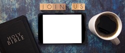 Join Us in Block Letters on a Wooden Table with a Bible and Tablet