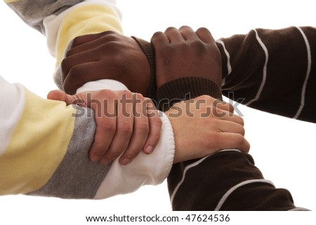 joined hand of a multiracial team (isolated on white) - stock photo