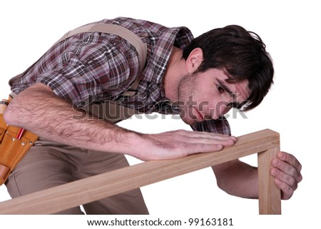 Joiner checking his work