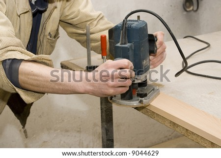Joiner making furniture in his manufactory