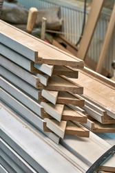 Joinery. Stacked door architraves. Wood door manufacturing process. Woodworking and carpentry production. Furniture manufacture. Close-up