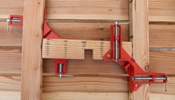 Joining wood 90 degree corner clamp by angle clamp tools. Craft Activities. Create a wooden furniture.