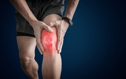 Joint pain, Arthritis and tendon problems. a man touching nee at pain point