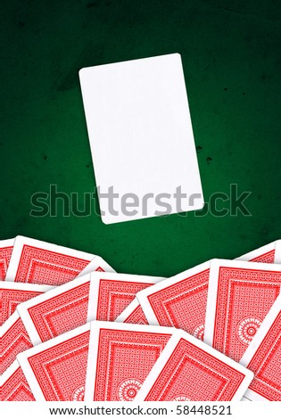 Joker card and other playing cards over green, grungy background