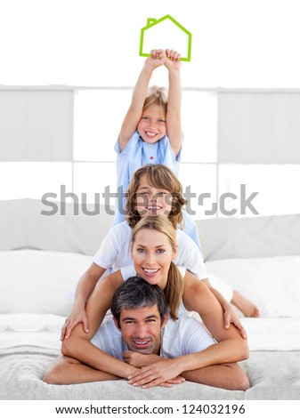 Jolly family having fun with green house illustration in the bedroom
