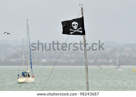 Jolly Roger - Flag of a pirate skull and crossbones. Concept photo of sea piracy