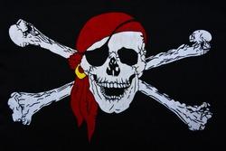 Jolly Roger on black textiles background