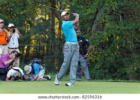 JONHS CREEK, GEORGIA, USA - AUGUST 10: Tiger Woods takes a shot during practice rounds at the 2011 PGA Championship tournament on August 10, 2011 in Johns Creek, Georgia, USA.
