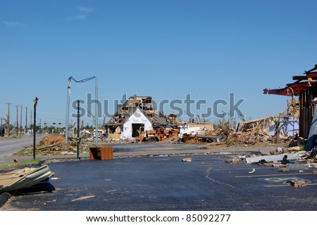JOPLIN, MISSOURI - MAY 22: A devastating EF5 multiple-vortex tornado destroys the city of Joplin, Missouri on May 22, 2011. Nearly 200 are killed and the city is left strewn with debris.