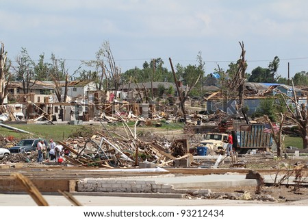 JOPLIN, MO.-JUNE 25:Clean-up continues on the massive damage caused to 1/3 of the city by the historic EF-5 Tornado that tore through this small midwestern city over a month ago June 25,2011 in Joplin