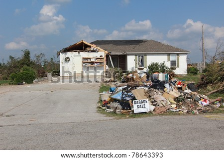 JOPLIN, MO - MAY 22: It's said that humor can help relieve tension in extreme situations, so this well placed sign in the aftermath of a killer EF-5 tornado should bring some relief and smiles to those who can use them. May 22, 2011 in Joplin, Missouri