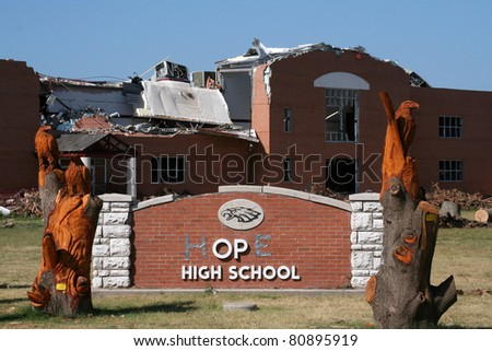 """JOPLIN, MO USA--JULY 12:  The Joplin High School after the EF-5 tornado on May 22, 2011.  With 2 letters from """"Joplin"""" that survived the storm, someone added duct tape to form the word """"hope."""""""