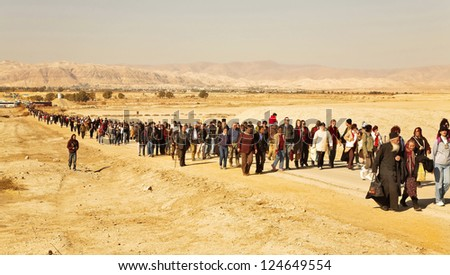 JORDAN VALLEY, ISRAEL - JANUARY 18: Day of a sacred Christening of Jesus  with going pilgrims. January 18, 2008, Jordan valley, Israel. 5 km north of the Jordan River flows into the Dead Sea - stock photo