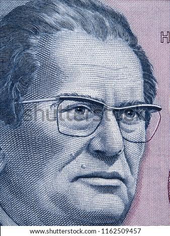 Josip Broz Tito portrait on Yugoslavia 5000 dinara (1985) banknote closeup macro, leader of Yugoslav communist revolutionary, President of Yugoslavia. Stock fotó ©