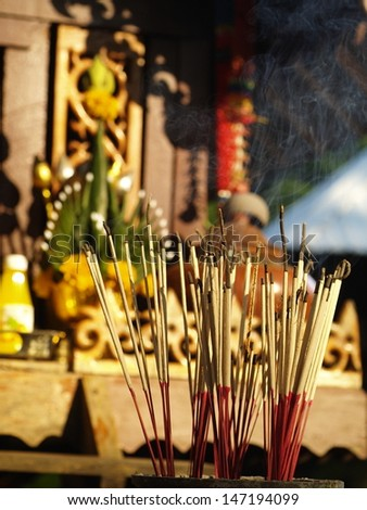 joss sticks and candle in a buddhism temple in Thailand