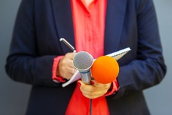 Journalist or reporter at news conference or media event. Journalism concept.