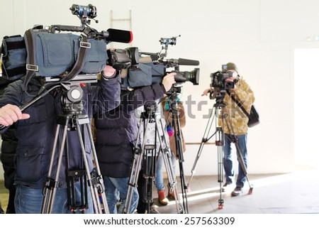 Journalists from different of channels taking an interview