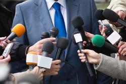 Journalists interviewing VIP